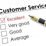 tick placed in excellent check box with fountain pen over customer service